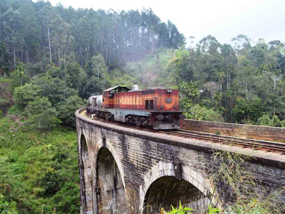 Nine Arches Bridge in Ella Sri lanka. if you want to take this type of photo, make sure you go with a friend and take at least 2 Camera. one to take photos and Video